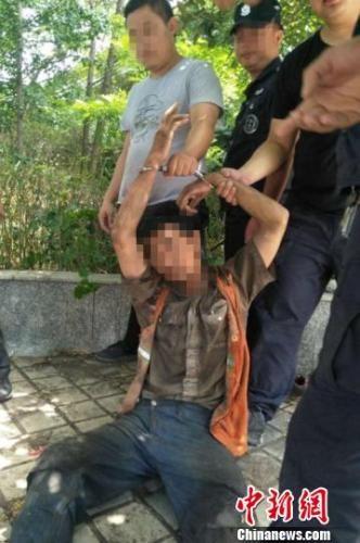 马廷江在湖南怀化新晃火车站货场被警方抓获归案。怀化警方供图